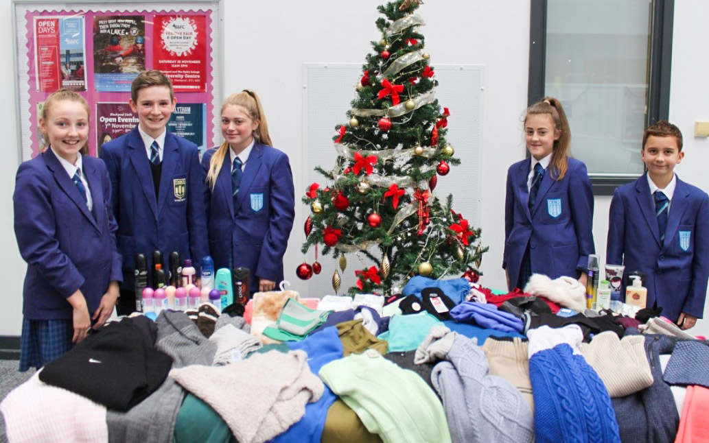 Highfield pupils send warm clothing & warm wishes to town's homeless